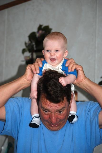Josiah loves being up on his grandpa's shoulders